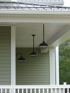 Three barn lights on a porch