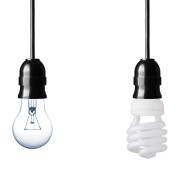 Hanging bare Incandescent Light Bulb next to Compact Fluorescent Bulb