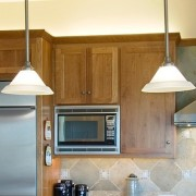 Three pendant lights over a kitchen island